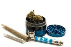 Marijuana Joint, Pipe and Grinder on White Background. Horizontal Image Royalty Free Stock Image