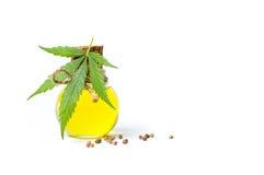 Marijuana leaf and cannabis oil isolated. On white Royalty Free Stock Photo