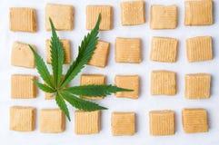Marijuana leaf and caramel candies royalty free stock photography