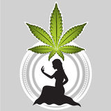 Marijuana leaf with girl silhouette Stock Photo