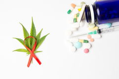 Marijuana leafs, fight cancer sign and medicaments Stock Photography