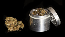 Marijuana and metal grinder Stock Photography