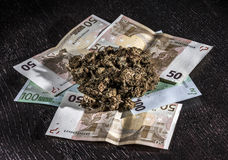 Marijuana and money. Marijuana and some banknotes, two fifty and three hundred euro notes Royalty Free Stock Photography