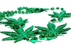 Marijuana Necklace. Isolated marijuana necklace with beads used for Mardi Gras Stock Images