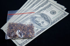 Marijuana packet on US currency Royalty Free Stock Images