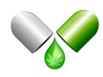 Marijuana portion capsule. Green and white marijuana portion capsule. it is open and drop of contain Stock Images