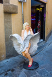 Marilyn Monroe sculpture in front of an amusement arcade in Florence. Monroe was actress and model, she was one of the most popula. Florence, Italy - July 06 Royalty Free Stock Images