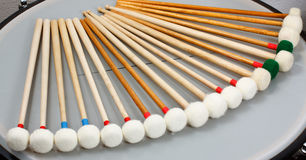 Marimba mallets. With white heads resting in a quarter circle Royalty Free Stock Photography