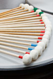 Marimba mallets. With white heads resting in a quarter circle Royalty Free Stock Image