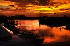 marina över solnedgångskymningzon Fotografering för Bildbyråer