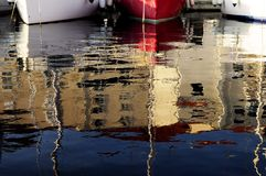 Marina. Reflection of boat and city on water royalty free stock image