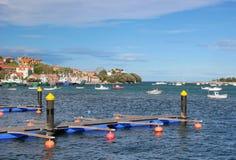 Marina. Empty marina piers with some boats nearby Stock Photo