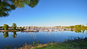 Marina. Early morning sunrise at the marina with the water mirror calm and the sky cloudless Royalty Free Stock Image