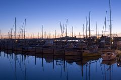 Marina. View of Rangitoto Island taken from Westhaven Marina looking over moored yachts stock image