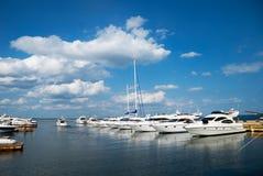 Marina. White yachts over blue sky Stock Photography