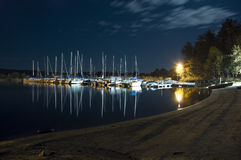 Marina. Many boats docked during night at a local marina Stock Images