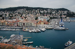 Marina aerial view of Nice, France. City center aerial view of Nice, France. Marina at the bottom surrounded by old town buildings. Ferry at the right side Royalty Free Stock Photography