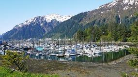 Marina in Alaska. Marina in Juneau, Alaska, next to snowcapped mountains Stock Image