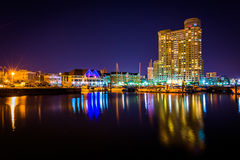 Marina and apartment building at night in Baltimore, Maryland. stock photos