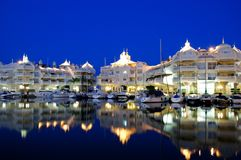 Marina area at night, Benalmadena, Spain. Boats and apartments in the marina at night, Benalmadena, Costa del Sol, Malaga, Province, Andalusia, Western Europe Stock Photography