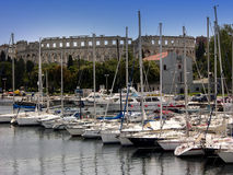 Marina with arena in background in Pula,Istria Royalty Free Stock Images