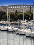 Marina with arena in background in Pula,Istria Royalty Free Stock Image