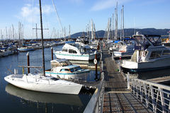 A Marina in Astoria Oregon. Boats of all types and shapes parked at a marina in Astoria Oregon Stock Images