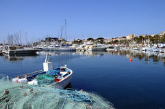 Marina of Bandol in France. View of fishing nets, boats and provencal village of Bandol Stock Image