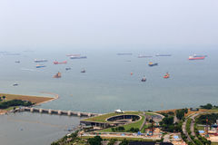 Marina Barrage dam and cargo ships lying in the roads off the coast of Singapore Stock Images
