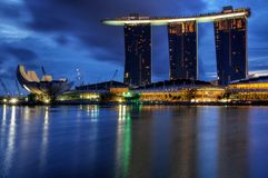 Marina Bay : Blue Hour Landscape. A blue hour photo of the Marina Bay Sands Hotel and Integrated Resort with the Singapore Arts and Science Museum and the Double Royalty Free Stock Photo