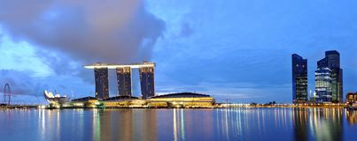 Marina Bay, Blue-Hour Panorama. A panoramic view of the Marina Bay landscape taken early at night Royalty Free Stock Photo