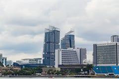 Marina Bay Cityscape med molnigt i afton Royaltyfri Bild