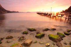 Marina in the bay at dawn. Pier in a small bay at dawn Royalty Free Stock Photo