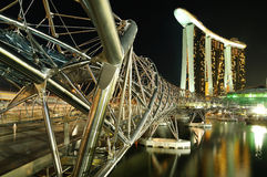 Marina Bay : Helix Bridge. A blue hour photo of the Marina Bay Sands Hotel and Integrated Resort and the Double Helix Bridge Royalty Free Stock Photo