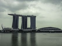 Marina Bay with most spectacular hotel background in the cloudy day in the dark tone of the image. Singapore. - on January 7, 2014. at Marina Bay with most stock photos