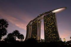 Marina bay sand hotel reflection at Gardens by the Bay at dusk Royalty Free Stock Photos