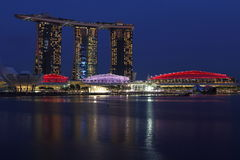 Marina Bay Sand in Singapore flag colours at blue hour Royalty Free Stock Image