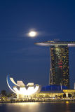 Marina Bay Sands. Night shot of moon over Marina Bay Sands Hotel and Integrated Resort, and the Singapore Arts and Science Museum Royalty Free Stock Photo