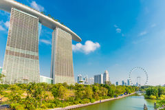 The Marina Bay Sands against blue sky and singapore flyer Stock Photography