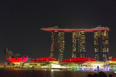 Marina Bay Sands in Singapore by night. Marina Bay Sands complex is topped by a 340-metre-long 1,120 ft SkyPark with a capacity of 3,900 people and a 150 m 490 Royalty Free Stock Photo