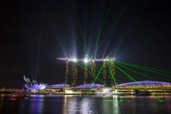 Marina bay sands with dancing laser lights Stock Photos