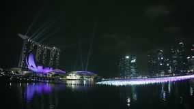 Marina Bay Sands and decorated gulf before the celebration of the new year at night stock footage