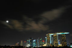 Marina Bay Sands with a Full Moon and a Moving Clouds Stock Images