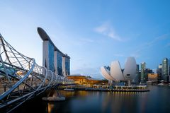 Marina Bay Sands and Helix bridge in Downtown Singapore city in Bay area. Financial district and skyscraper buildings with blue. Sky stock photography