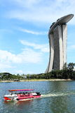 Marina bay sands hotel and boat is navigating Royalty Free Stock Images