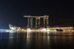 Marina Bay Sands hotel at night with light and laser show in Singapore. The luxury resort is a landmark in Singapore. The laser show starts every evening Royalty Free Stock Photography