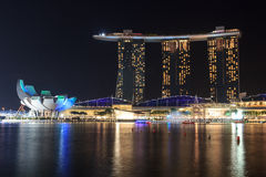 Marina Bay Sands hotel at night with light and laser show in Singapore. The luxury resort is a landmark in Singapore. The laser show starts every evening Royalty Free Stock Images