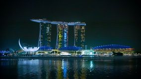 Marina Bay Sands hotel at night with reflection in water Stock Footage