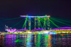 Marina Bay Sands laser show. Singapore - April 27, 2018: great laser show at night time at Marina Bay Sands Hotel and Casino and ArtScience Museum. Laser lights Royalty Free Stock Photos