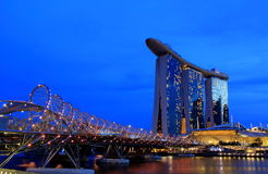 Marina bay sands skyline at night in singapore. Singapores Double Helix Bridge with Marina Bay Sands and Sky Park in the night Royalty Free Stock Photos